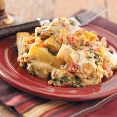 Creamy Spinach Sausage Pasta.   - cook penne or rigatoni al dente  - in skillet or dutch oven cook bacon, italian sausage, and chopped onion until sausage is not pink  - add cream cheese, mozarella, italian diced tomatoes, and thawed frozen spinach, mix thoroughly  - mix with pasta and pour into baking dish  - bake at 350 for 35 min. add mozarella on top and continue baking until cheese is melted