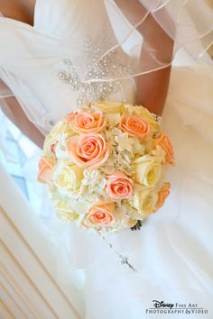 Classic and always chic yellow and peach roses were the perfect fit for this Disney bride #wedding #bouquet #roses