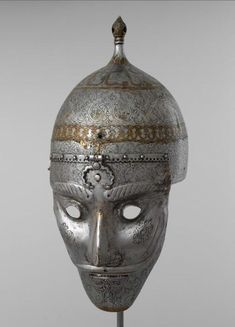 Helmet with mask. Iran, the XVIth century. Steel; engraving, forging, gilding.