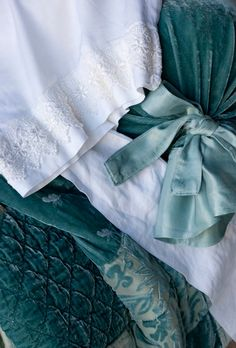 Sophia comforter in Seaglass, satin pillowcase with Venise lace edge, silk velvet bolster in Seaglass