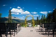 Yellow flowers against a bright blue sky at  a TenMile Station wedding in Breckenridge, Colorado! http://www.iconicweddings.com/Destinations/Breckenridge/Venues/Ten-Mile%20Station.aspx Photo by Brinton Studios.  JA Special Events. #mountainwedding