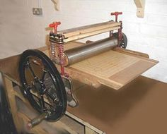converted mangle press that prints from relief blocks, intaglio plates and litho plate