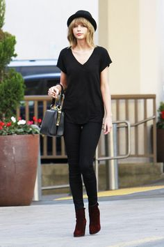 Taylor Swift ambles down a Los Angeles street wearing head-to-toe black, topped off with a porkpie hat, because bad hair days afflict even the history-making performers among us.