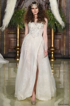 Galia Lahav Spring 2016...Interesting skirt details.I see leather. More beautiful detail to recreate for that ultimate bridal look.Get that designer look by having it custom-made.