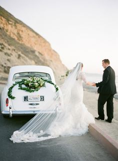 White Classic Wedding car with greenery decoration