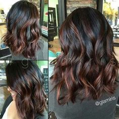Beautiful color dimension! Very dark brown hair with warm brown highlights mixed in!