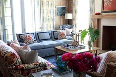 Beautiful living room with French doors dressed with ivory and blue paisley block print drapes.