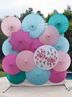 Could be cool if you wanted to do a DIY photo booth at the reception!  DIY Bright Parasol Backdrop by asubtlerevelry: Great idea for a photo drop. #Photo_Drop #Parasol