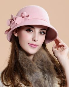 I love the flower trim on this-makes me want to buy a pink hat and I hardly ever wear pink!