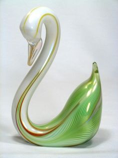 "GlassMaster Stuart Abelman enjoys creating art glass animals.  Pictured is his elegant Green Feathered Swan with graceful pose and  neck in pearl white.  It is signed ""Abelman"", dated and numbered MS4401-11.  It measures approximately 7.75""h x 5.0""w."