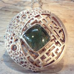 a 95% silver pendant with moldavite emerald orange by StoneDance