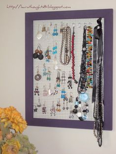 jewlery hanger - would be nice with knobs on the side for necklaces
