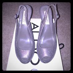 """Jennifer Lopez Slingback Peep toe heels Jennifer Lopez sling back gray peep toe heels. Size 6. Never worn. Heel height is 5"""". Jennifer Lopez Shoes Heels"""