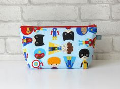 Superhero wash bag with waterproof lining. Lots of designs available in our Etsy store. #ollieandroo #washbag #giftsforchildren