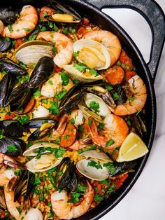 This seafood paella recipe with shrimp, clams, mussels paired with chorizo is the perfect family meal bursting with flavor.