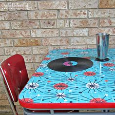 "How To Refinish a Table With Fabric and Resin..{Crafts-Unleashed}..""Mod Podge fabric to a side table, pour resin on top, let it dry overnight into something fabulous!""..the record is under the resin, too.. how cool is that?!"