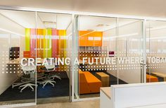 Environmental Graphics in Truth Initiative HQ 01: These large scale graphics displayed on the office's movable glass walls give a great example of how you can showcase your brand in the workplace and make the feature more customized.