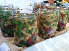 """Pickled Three Bean Salad  4 1/2 c. slice 1 1/2"""" green beans  4 1/2 c. slice 1 1/2"""" yellow wax beans  1 lb lima beans or garbanzos        (I substituted a combination of kidney & garbanzo weighing a total of 1 lb.)  2 c. sliced celery  1 2/3 c. sliced onion  1 c. diced red bell pepper  Boiling water  2 1/2 c. sugar  1 T. mustard seeds  1 t. celery seeds  4 t. canning salt  3 c. white vinegar  1 1/4 c. water  Cook beans, celery, onions and red peppers,boil 5 min. Drain hot veg.& pack into hot…"""