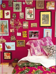 i want to have this wall...i love the color..the art..the frames...all of it...  pink wall with eclectic frames