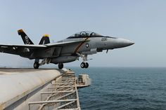 An F/A-18F Super Hornet from the Jolly Rogers of Strike Fighter Squadron (VFA) 103 launches from the flight deck aboard the Nimitz-class aircraft carrier USS Dwight D. Eisenhower (CVN 69) #USNavy