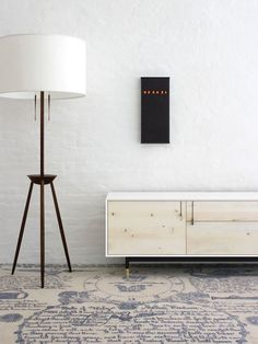 Drooling: Tyler Hays. BDDW's Tripod lamp of claro walnut complements a blackened bronze Nixie wall clock and a Lake credenza of white lacquer and American holly. Photo: Courtesy of BBDW