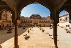 Chomu Palace, a reflection of the Royal Palaces of India, is a elegant fortified palace hotel and one of the places to visit in Jaipur Rajasthan. Jaisalmer, Udaipur, Jodhpur, Best Places To Travel, Cool Places To Visit, Mysterious Places, India Tour, Le Palais, Tourist Places