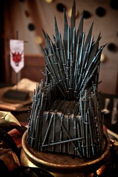 Victoria Malabrigo submitted:  Mini-Iron Throne sculpture using sword toothpicks, popsicle sticks, sculpey clay, craft glue, and black & silver spraypaint Designed for a Game of Thrones-inspired dinner party :)