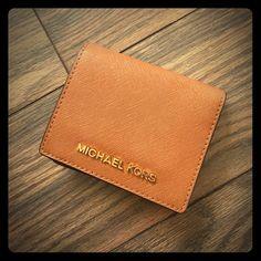 Michael Kors wallet Brand new, never used. Light brown leather, gold logo KORS Michael Kors Bags Wallets