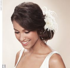 The ostrich feathers are elegant and romantic. Matches the dress.