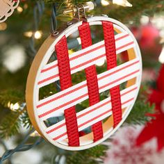 Scandinavian Christmas Decorations - Nordic Christmas Decor - Good Housekeeping Woven ornament - this would be cute to do with a larger embroidery hoop. Swedish Christmas Decorations, Christmas Ornaments To Make, Christmas Holidays, Holiday Decorations, Christmas Ribbon Crafts, Traditional Christmas Ornaments, Scandinavian Christmas Ornaments, Homemade Christmas Crafts, Christmas Tables