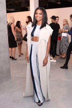 Who: Gabrielle Union What: A Sleeveless Trench Why: The actress looked elegant yet seasonally appropriate in a cut-out jumpsuit, layered with a sleeveless, floor-sweeping coat. Get the look now: Tome trench, $550, avenue32.com.   - HarpersBAZAAR.com
