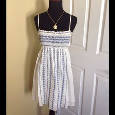 Forever 21 Ivory & Blue Embroidered Tunic Top Ivory & Blue embroidered Tunic top/dress. Purchased from FOREVER 21. Worn a couple of times. In good condition. Size Medium. Time to find it new home. Send me an offer  Twenty One Tops Tunics