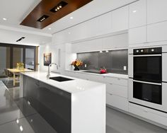 Contemporary Kitchen. Glossy surfaces. White frameless cabinets. Rectilinear lines.