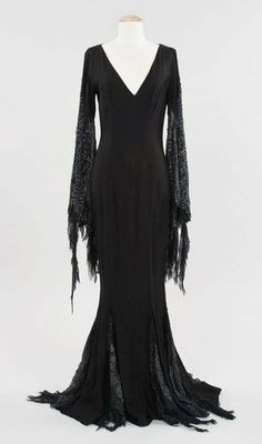 """Angelica Huston """"Morticia Addams"""" dress from Addams Family Values. (Paramount, A full-length form-fitting black gown with cobweb motif on the sleeves worn by Angelica Huston in the role of """"Morticia Addams"""" in Addams Family Values. Addams Family Values, The Addams Family, Dark Fashion, Gothic Fashion, Steampunk Fashion, Emo Fashion, Morticia Addams Kostüm, Mode Sombre, Halloween Karneval"""