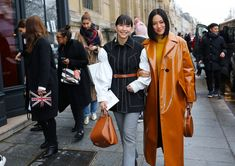 Clara Cornet in Ellery with a Loewe bag and Tiffany Hsu in Mansur Gavriel with a Mansur Gavriel bag