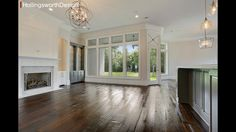 Wood floors and tall windows. What a view!