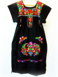canasta de flores mexican embroidered dress. $88.00, via Etsy.