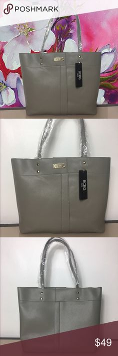 ❤️BCBG Paris Tote set of 2 BCBG Paris Tote bag Beautiful Grey color . Set of 2 bags. Includes tote and pouch Tote: 11.5'' W x 16.5'' H x 4.5'' D Pouch/Bag: 14'' W x 7.5'' H x 4.25'' D 10'' handle drop 50'' max. strap length Outer: man-made Lining: polyester Zip closure Interior: one zip and two slip pockets and center divider Exterior: one zip pocket Removable crossbody strap Imported New with tags attached, straps still in plastic BCBG Bags Totes