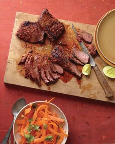 Thai Skirt Steak with Carrot Salad Recipe   Martha Stewart Living _ Red curry paste and lime zest do wonders for affordable skirt steak. Let it marinate overnight for maximum flavor.