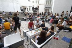 Old bathtubs become seating for public square. 'Art Square in a Fountain' by Art Pit in Kaunas, Lithuania.