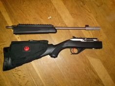 """Ruger 10/22 Takedown; SPEC-OPS Rifle Cheek Pad, Small LimbSaver Recoil Pad (to extend length of pull,) Tapco forend Top Rail, Williams """"Ace in the Hole"""" peep sight & rail with red optic front sight, NcStar Muzzle Break/Flash Hider --- Kidd Innovative Design: black mid field weight (1.25/2.5lb) two stage trigger assembly with custom bolt release and extended mag. release, full bolt kit, spring & guide rod, silver with black Viton extended bolt handle, two piece viton buffer pin, receiver pin…"""