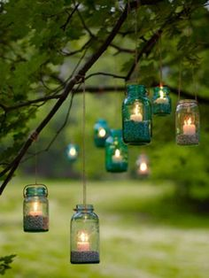 Up-cycled glass jars make for lovely glass lanterns with tea lights placed in side. A fantastically cheap way of creating ambient outdoor light. Use plenty of them, and mix sizes and colours to make a simply stunning display! Lovely for garden parties, weddings or just because. #gardenparty #tealights