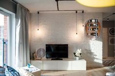 Affordable Apartment Makeover Relies on Inspired Custom Solutions Apartment Decorating On A Budget, Apartment Makeover, Apartment Interior Design, Design Interior, Decorating Kitchen, Living Room Ideas 2019, Style Loft, White Wash Brick, Small Apartments