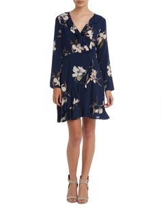 Feminine and flirty, this fixed cross-over dress in a pretty floral print has long-sleeves, a ruffle hem and invisible side zip. Women's Fashion Dresses, Dress For You, Floral Prints, Cold Shoulder Dress, Feminine, London, Crossover, Long Sleeve, Pretty