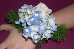 corsage for mothers......pink color rose with the blue hydrangea  use same idea for grandmothers but theirs will pin on