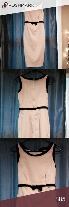 White PUG Wiggle Dress Worn twice, gorgeous white wiggle dress with black velvet piping and Bow accent. This dress hugs every curve perfectly and is extremely comfortable movement wise. Small slit in the back. GREAT condition Pinup Couture Dresses Midi