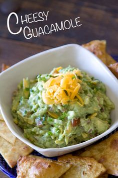 Cheesy Guacamole  3 ripe Hass avocados   1/3 cup chopped red onion   1/3 cup shredded cheddar cheese   1/3 cup chopped fresh tomatoes   1/8 cup chopped chives   1/2 lemon, juiced   1/2 lime, juiced   1 tablespoon chopped jalapeño   Kosher salt and freshly cracked black pepper to taste