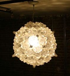 whole collection of bottle light fixtures including this soda bottle fixture at http://inspirationgreen.com/plastic-waste-lights.html
