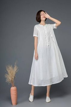 The white linen dress is made of linen blend. The day dress has a linen lining. The long dress is very loose and comfortable. The womens dress has a button and trims on the front. The cute dress has two side pockets. ______________________________ Shop sizing chart FYI (made according to US