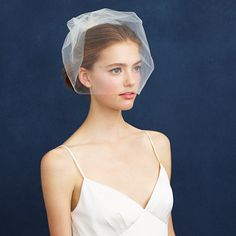 """Portland-based Myra Callan started Twigs & Honey when she was planning her own wedding and now offers her fresh and modern interpretation of hair adornments to brides and non-brides alike. This lightweight and sheer bridal veil is just the right amount of pretty (because every wedding dress needs a little extra <i>tszuj</i>). <ul><li>Length: 30 1/2"""".</li><li>Nylon.</li><li>USA.</li></ul>"""